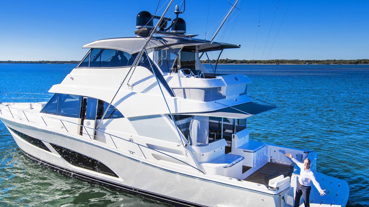 Riviera boss Rodney Longhurst with the company's new $3.2 million 64 Sports Motor Yacht. Picture: Nigel Hallett