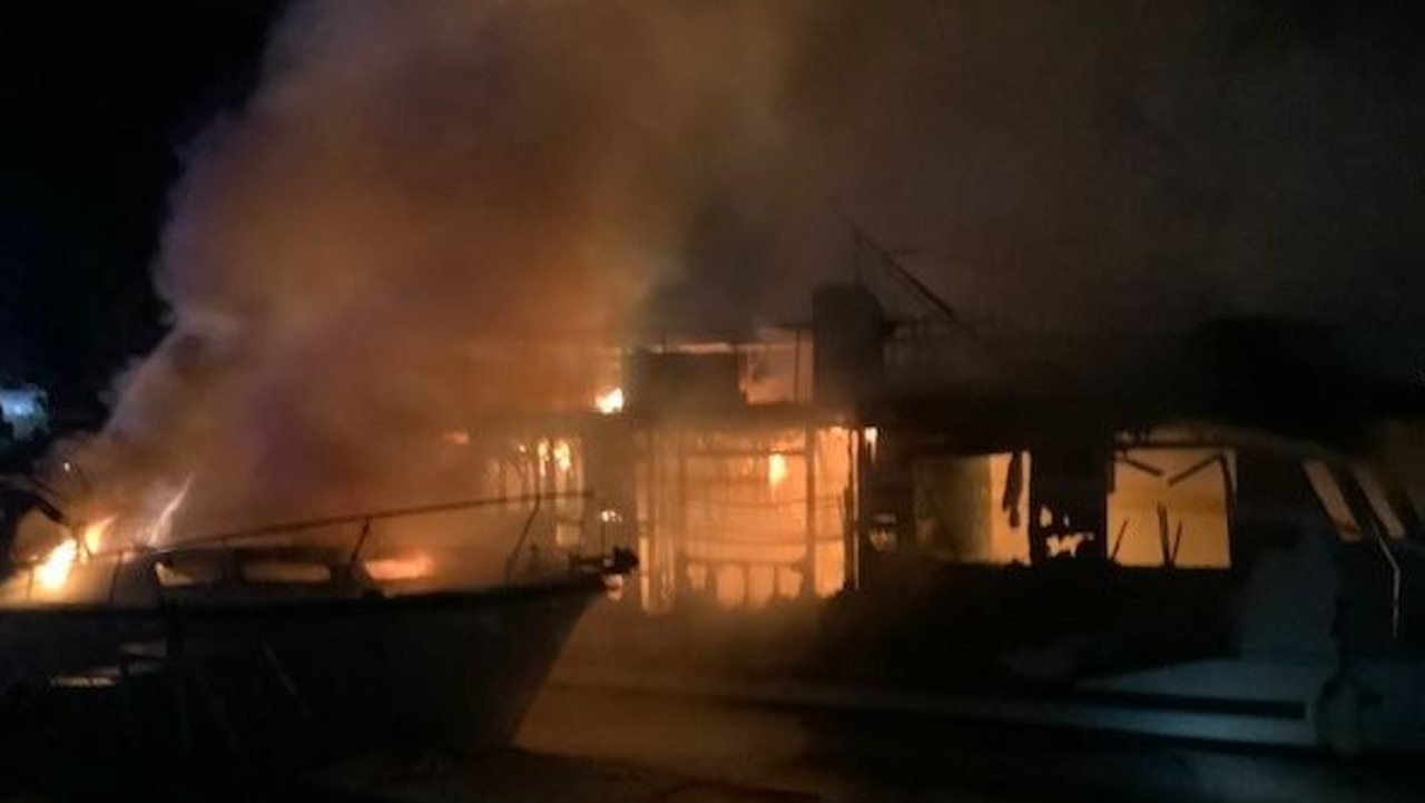 Two boats have been destroyed by a huge blaze at a marina.