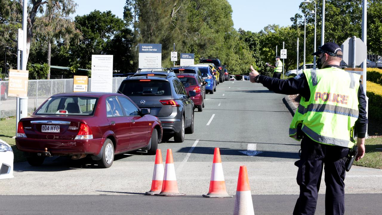 People in cars queue for Covid-19 testing at Caloundra Hospital on Thursday. Picture: Steve Pohlner