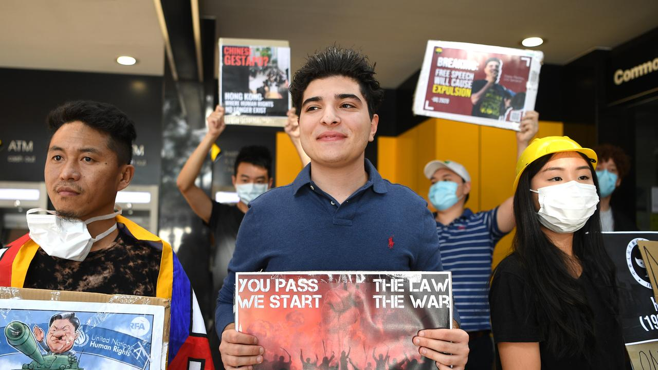 Not backing down: Drew Pavlou outside the Chinese consulate in Brisbane, protesting against the Hong Kong crackdown. Picture: NCA Newswire/Dan Peled.