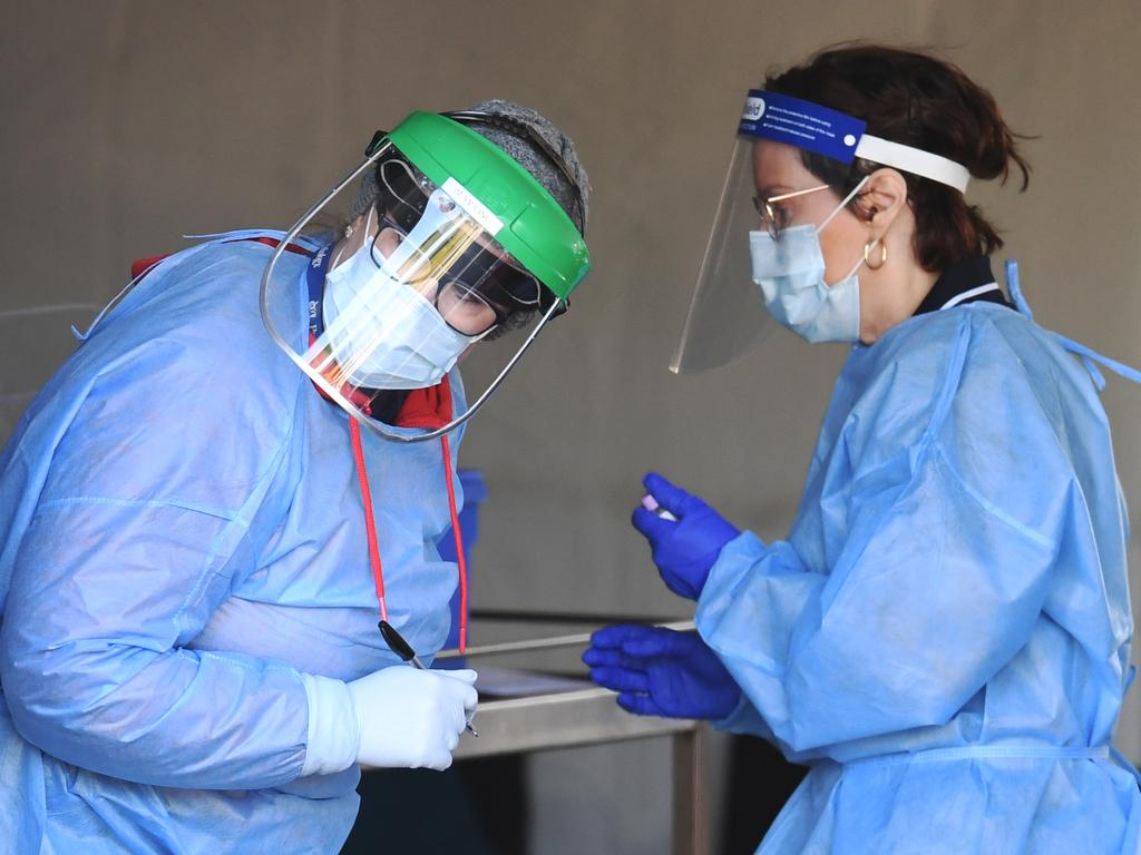 Health staff perform Covid-19 tests at a drive-through station in Brisbane. Picture: NCA NewsWire/Dan Peled