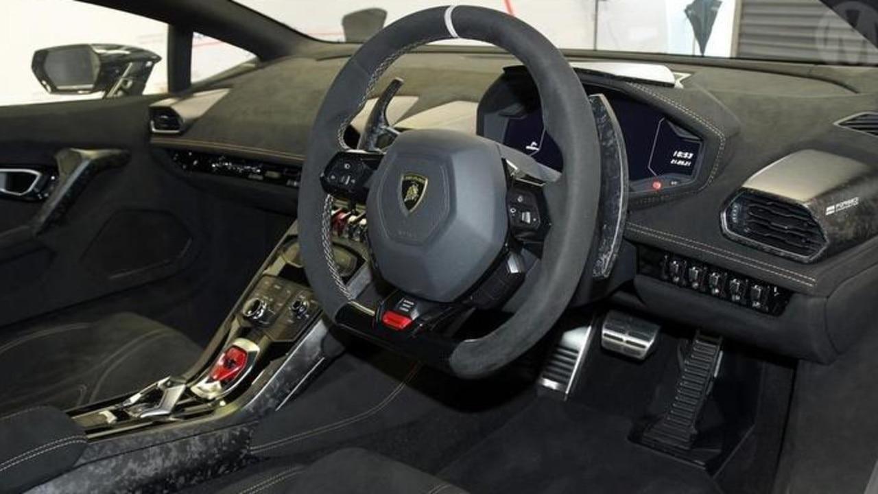 The interior features carbon fibre and suede-like Alcantara.
