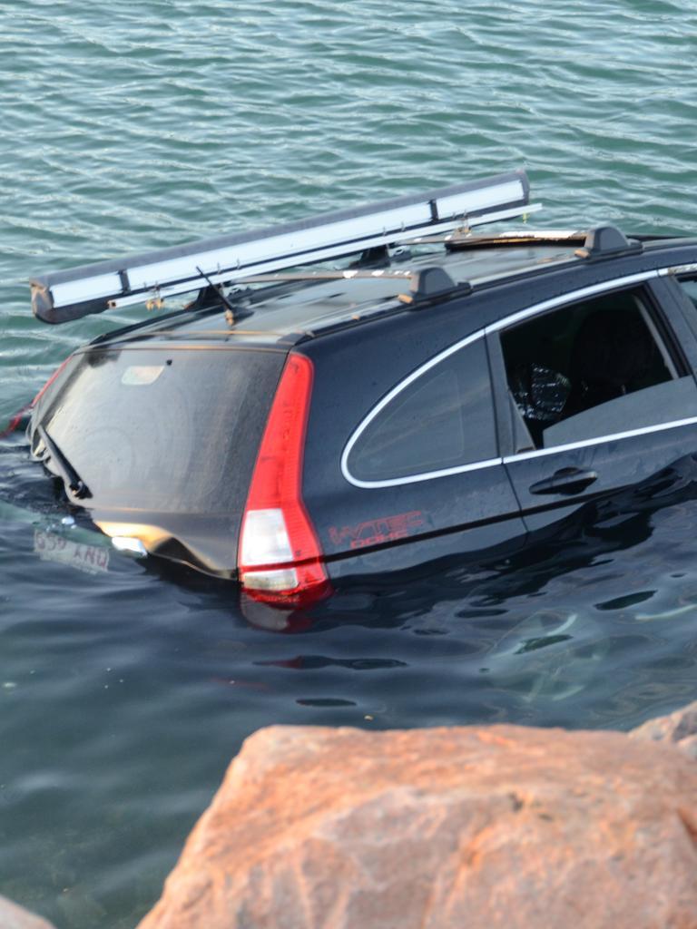 A stolen car dumped in Ross Creek in May.