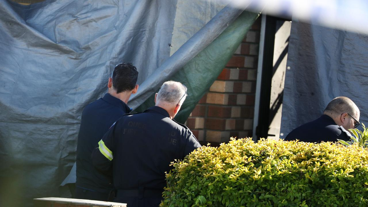 Investigators at the scene of a fatal house fire in Lowood. Picture: Annette Dew