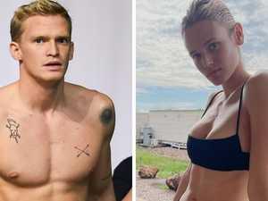 Cody, girlfriend get cosy after final swim