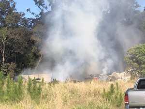 Large shed bursts into flames near hinterland servo
