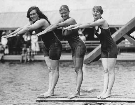Fanny Durack (gold) Mina Wylie (silver) and British swimmer Jennie Fletcher (bronze) celebrate the 100m freestyle at 1912 Olympic Games in Stockholm.
