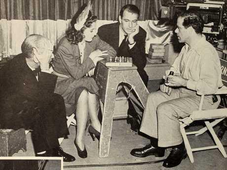 James Gleason, Barbara Stanwyck, Gary Cooper, and Frank Capra playing chess, 1940
