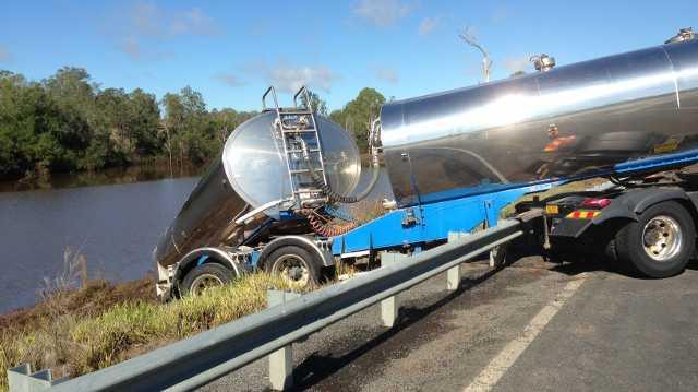 Road damaged causes tanker to tip