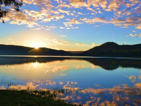 Mirrored Sunrise by Lirio Escano
