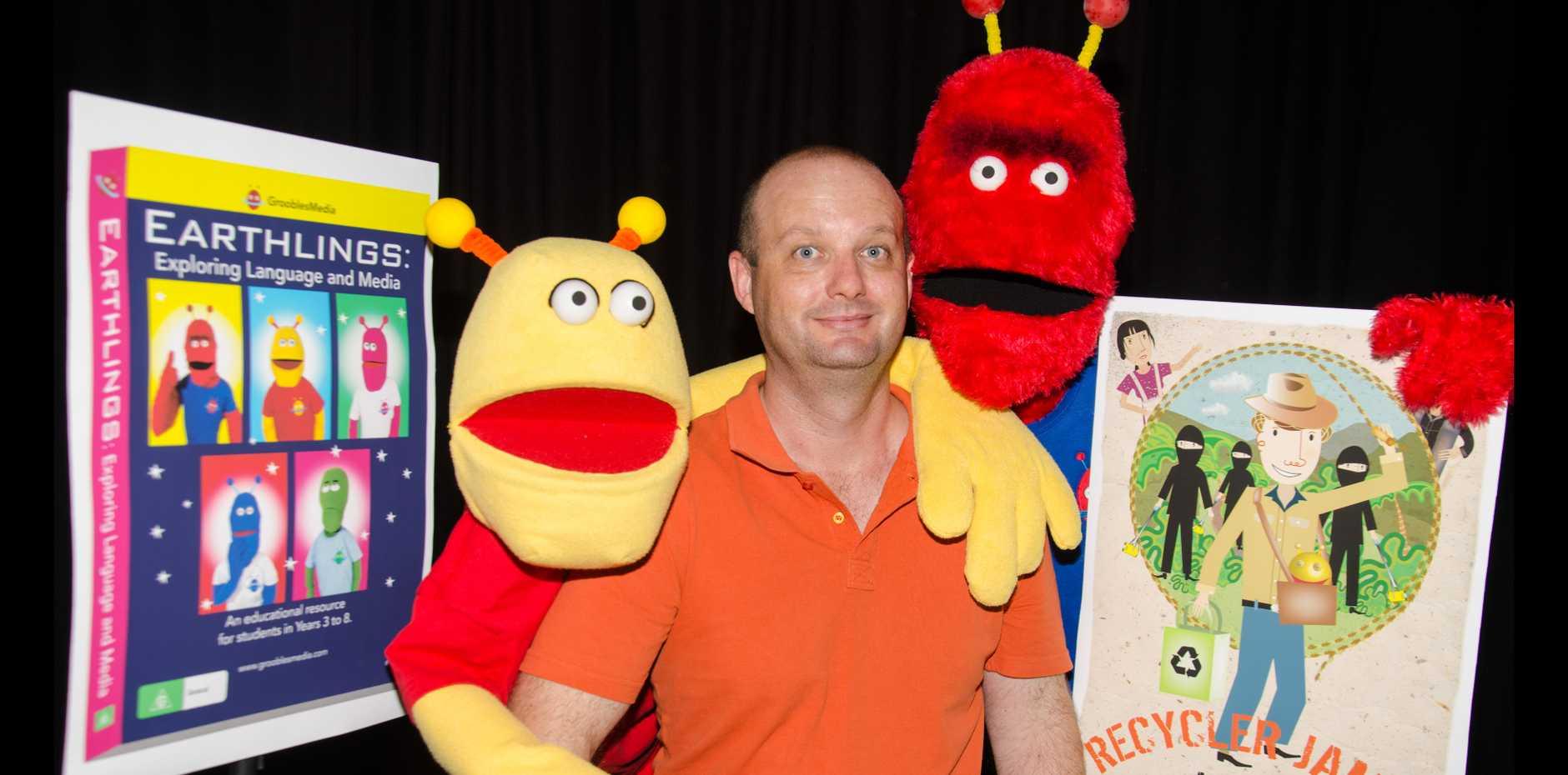 Jim Hancock with puppet aliens Milton and Harvey.