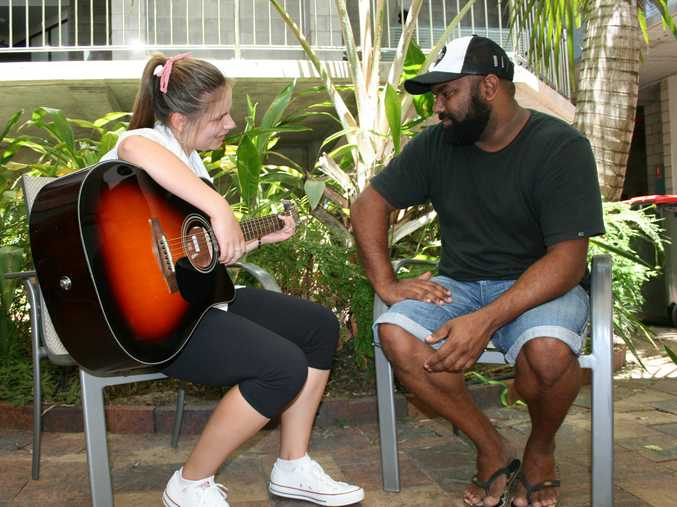 School student Caitie Hughes gets a few musical tips from Jeremy Marou. Photo by Greg Chapman