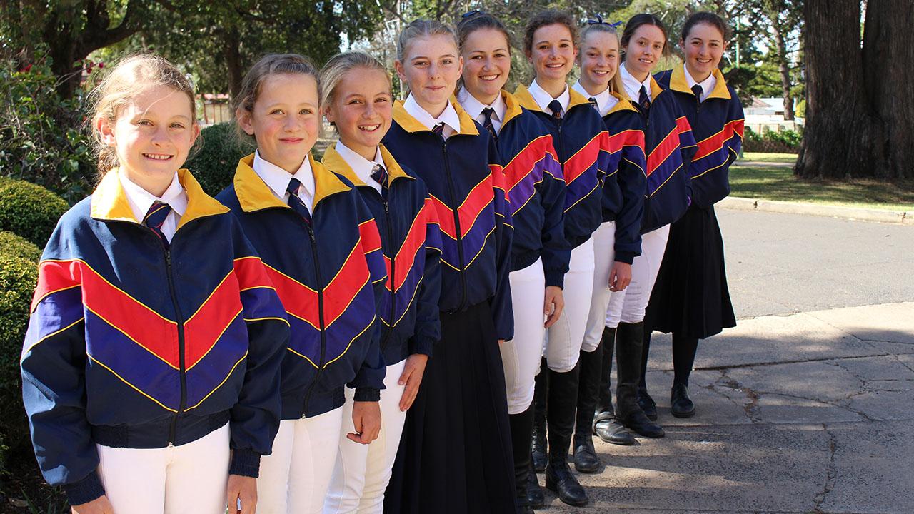From left to right: Grace Muirhead, Eve Muirhead, Holly Willmington, Sarah Coggan, Abbey Willmington, Philippa McKee, Shelby Emmerton, Nicole Murphy and Emily Coggan.