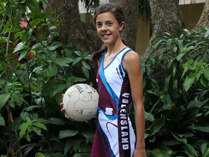 Ava proudly wearing her Queensland Netball uniform.
