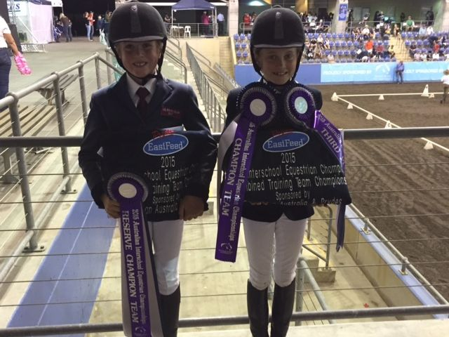 Eve (left) and Grace Muirhead displaying their wins.