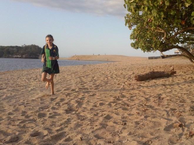 Eleni running on the beach in Currimundi