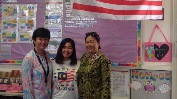 Mrs Janice Stevens (right) with mother and sister from Malaysia celebrate Harmony Day at Drayton State School.