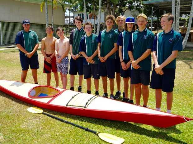 NDSHS DOE students build a boat.