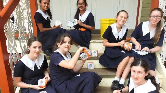 Year 6 Student Representative Council girls add finishing touches to a batch of bright beam torches bound for developing countries.  Pictured: Tanvi Chand, Prisha Gupte, Ruby Heffernan, Hannah Stunden, Harriet Davoren, Harriet Dummett and Amelie Clifford.