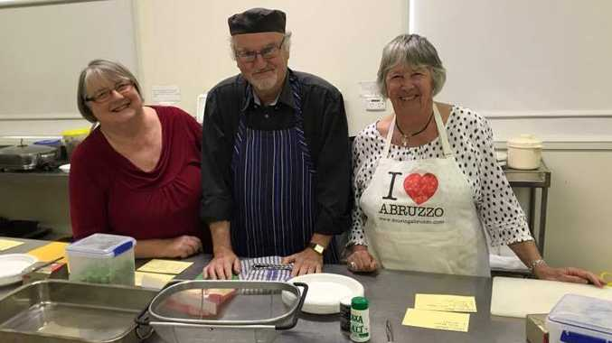 Carol Chalmers, Chris Clark and Sue English ready themselves for making 120 gourmet potatoes for Parkinson's supporters at the recent Potatoes for Parkinson's Luncheon.