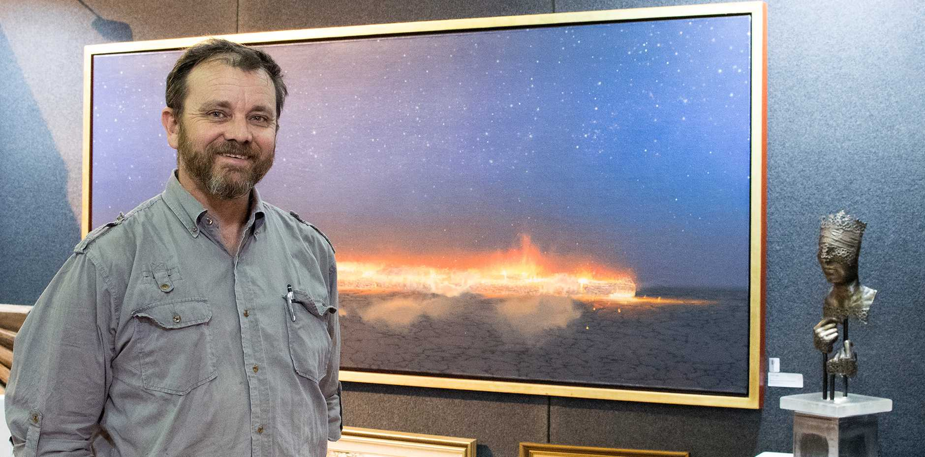 2019 RME Downlands Art Exhibition curator, Evan Hollis is pictured in front of Night (Starlight Line) by Tim Storrier
