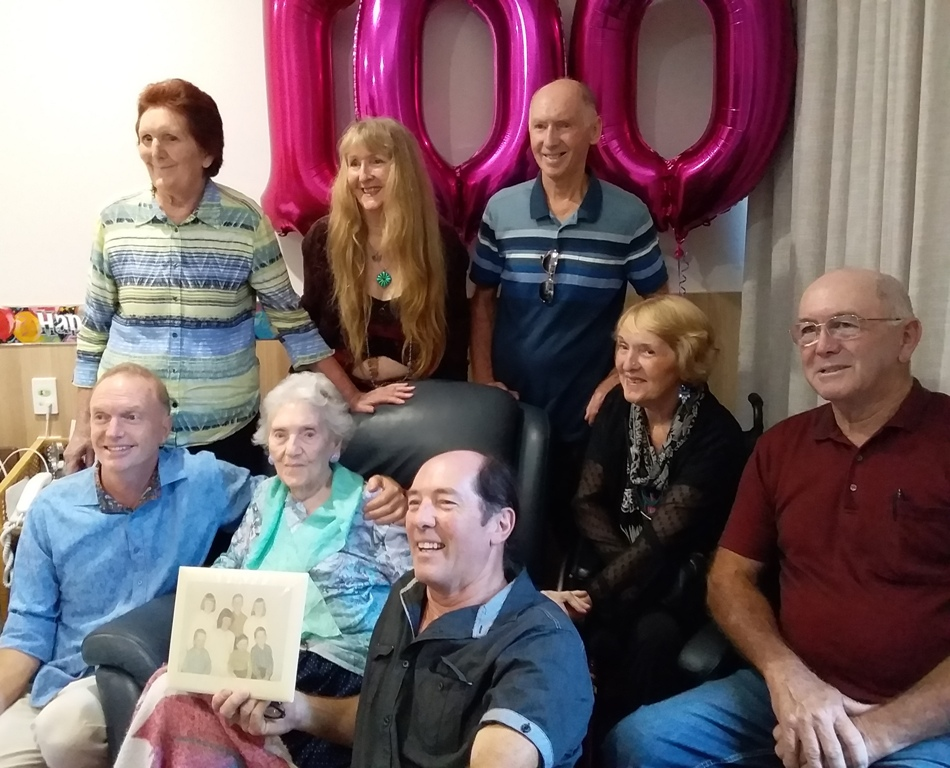 Lexie's seven children are, back row, L-R; Terese De Vere, Marie-Clare De Vere & Tony De Vere. Second row, Oshanji Dharma, Lexie, Xavier De Vere (holding photo of us when we were kids), Helen Waiwiri (in wheelchair) & Stephen De Vere.