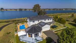 Offering space and tranquillity, this Grande design home sits high above the banks of the Clarence...