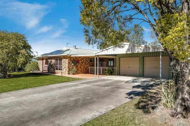 This neat and tidy brick home offers a superb lifestyle balance, combining acreage living with the...