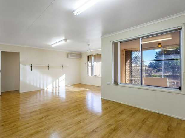 Family home with rural outlook perched on an acre under 30 minutes to Toowoomba.    This home offers...