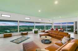 Perched 132 metres above sea level on the highest point of Mount Coolum Close this extraordinary res...