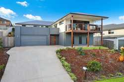 Less than two years old, this stylish family home sits in an elevated position on a 812m2 block in a...