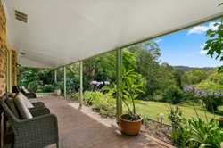 Located within minutes to both Nambour and Woombye centres this secluded retreat style property is i...