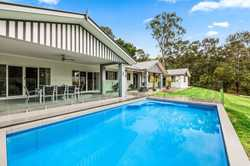 Perched at the top of a long concrete driveway. This very private north facing home assures the new...