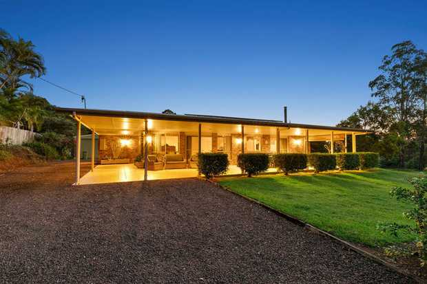 Sit and enjoy a wine and relax while gazing out across your 5,211m2 beautifully manicured  lawn and...