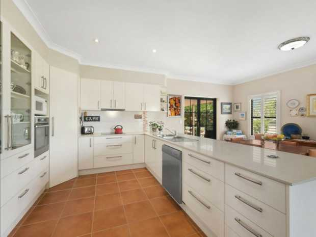 Deceptively spacious, this four bedroom family home welcomes formal and casual living option with high...