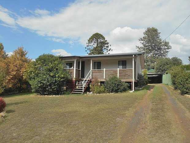 Relax out on the front or the back deck of this three bedroom renovated cottage.   Modern eat in...