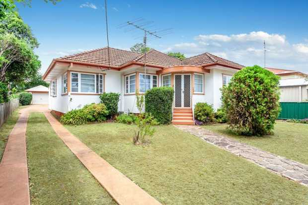 Located in a quiet part of Harristown is this Post War home with loads of potential. Keep the floor...