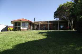 Low set 4 bedroom 2 bathroom brick & tile home set in child friendly cul-de-suc