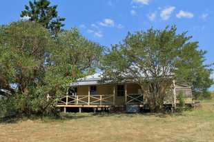 This 2 bedroom timber and iron home on 5 acres is in need of completing renovation.