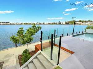 BRAND-NEW WATERFRONT HOME OFFERS THE LIFESTYLE YOU DESERVE
