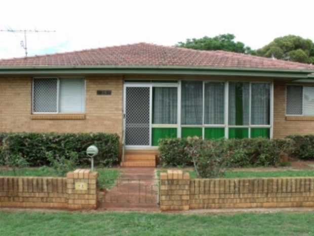 This lowset brick home in Harristown boasts three bedrooms (2 with built-ins), but the benefits don'...