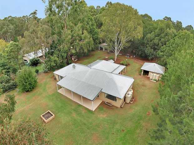 Nestled on a private fully fenced 3,967m2 allotment well set back from the road, the executive resid...