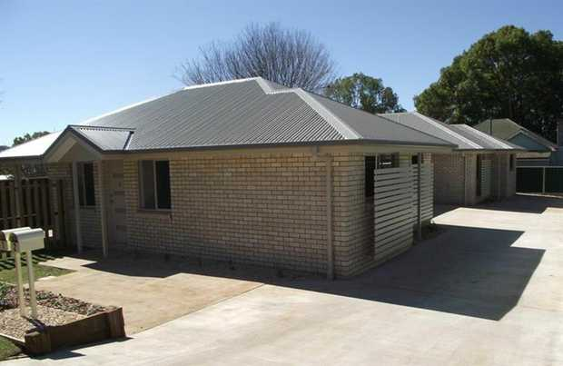 Make this lowset brick duplex with iron roof property your next home. Set within walking distance fr...