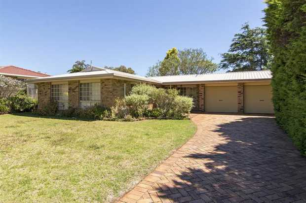 This lowset brick home in Centenary Heights is walking distance to the Bicentennial Waterbird Habita...