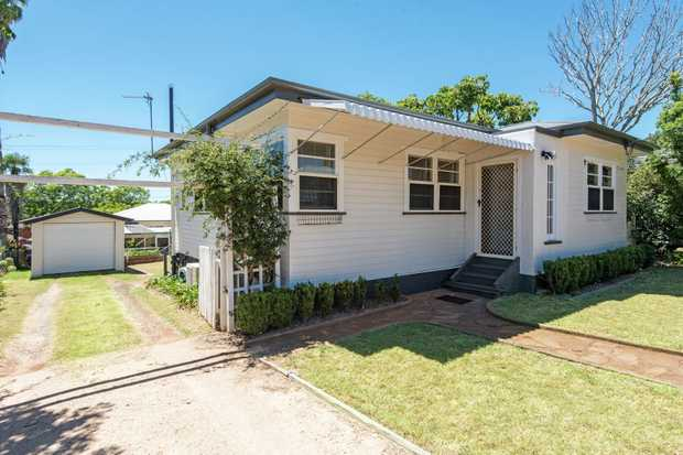 DELIGHTFULLY PRESENTED, this cute and affordable cottage is set in a hidden Harristown Street close...