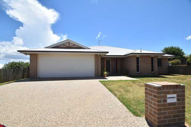 This lowset brick home in Harristown was built with a family in mind. Situated close to convenient s...