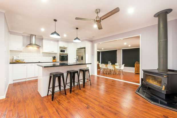This immaculately presented renovated residence represents the finest in modern family living. Embra...