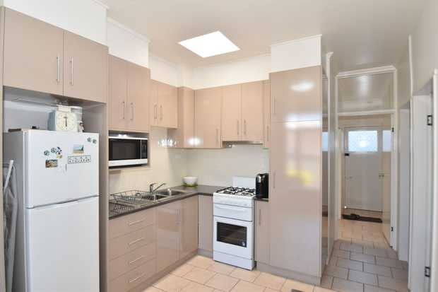Situated within a gated complex of 10 units, this well kept unit is within in walking distance to lo...