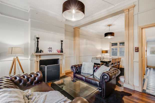 - Gorgeous terrace house built in 1905 - 4 carpeted bedrooms, main with built-ins and fire place -...