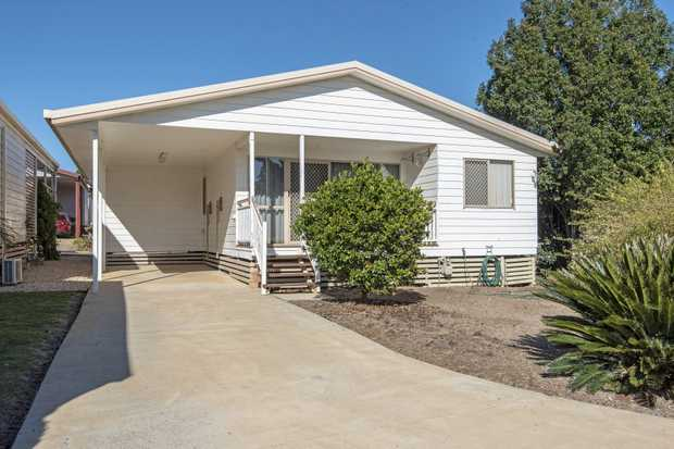 This 3 bedroom manufactured home sits peacefully in the Bridge Street Resort which offers much more...
